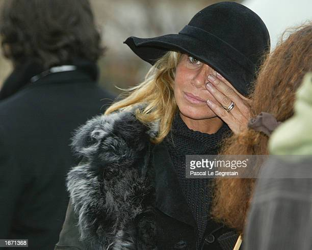 French actress Fiona Gelin wipes a tear as she attends the funeral services for French actor Daniel Gelin December 4 2002 in Paris Gelin known best...
