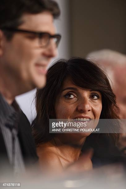 French actress Florence Foresti looks at US director Mark Osborne during a press conference for the film The Little Prince at the 68th Cannes Film...