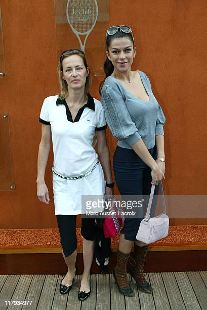 French actress Gabrielle Lazure and Model Jovanka Sopalovic pose in the 'Village' the VIP area of the French Open at Roland Garros arena in Paris...