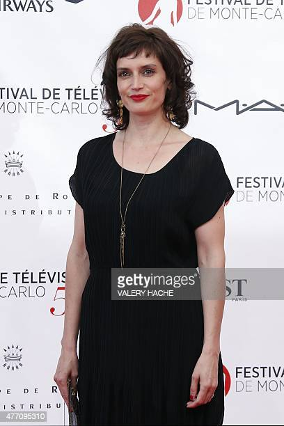 French actress Helene Seuzaret poses during the opening ceremony of the 55th Monte-Carlo Television Festival on June 13 in Monaco. AFP PHOTO / VALERY...