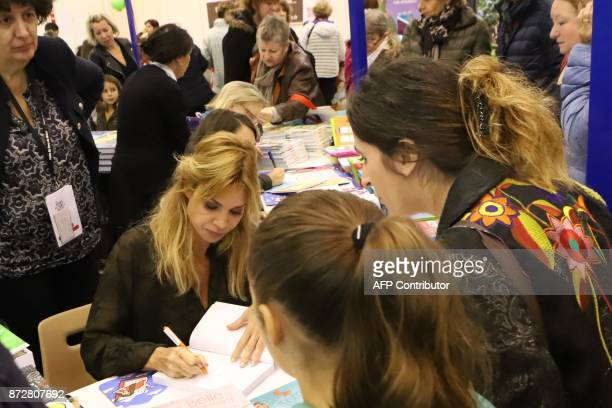 French actress Ingrid Chauvin signs her book during the 36th edition of the 'Foire du Livre de Brive' book fair on November 11 2017 in...
