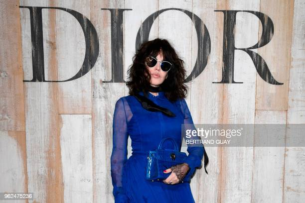 TOPSHOT French actress Isabelle Adjani poses during the photocall before the 2019 Dior Croisiere fashion show on May 25 2018 at the Grandes écuries...