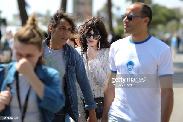 French actress Isabelle Adjani walks across the Croisette on May 12 2018 after attending a photocall for the film 'Le Monde est a Toi ' on the...