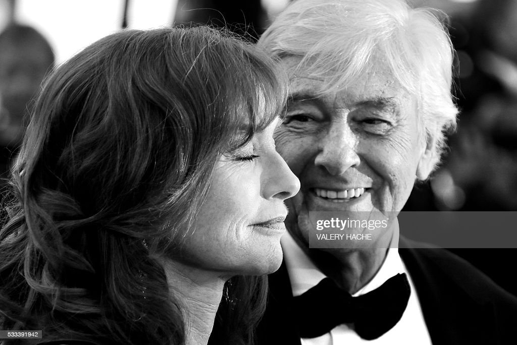 French actress Isabelle Huppert (L) and Dutch director Paul Verhoeven pose as they arrive on May 21, 2016 for the screening of the film 'Elle' at the 69th Cannes Film Festival in Cannes, southern France. / AFP / Valery HACHE