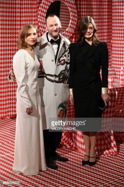 French actress Isabelle Huppert and FrenchItalian actress Chiara Mastroianni pose for pictures with Belgian artist and designer Charles Kaisin as...