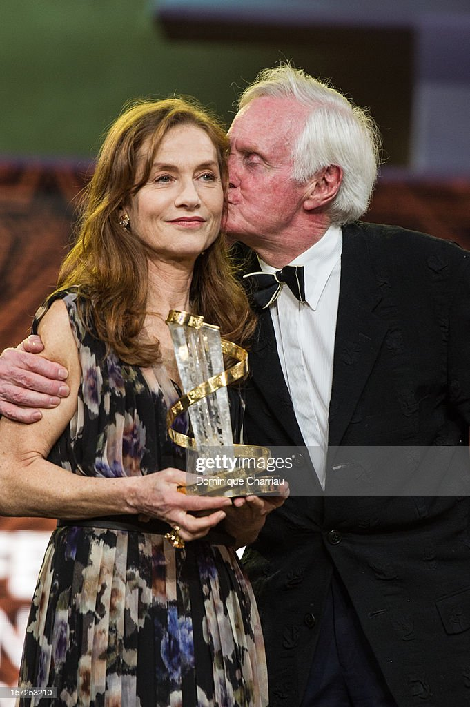 French Actress Isabelle Huppert and John Boorman pose during her tribute during the opening ceremony of the 12th Marrakech International Film Festival on November 30, 2012 in Marrakech, Morocco.