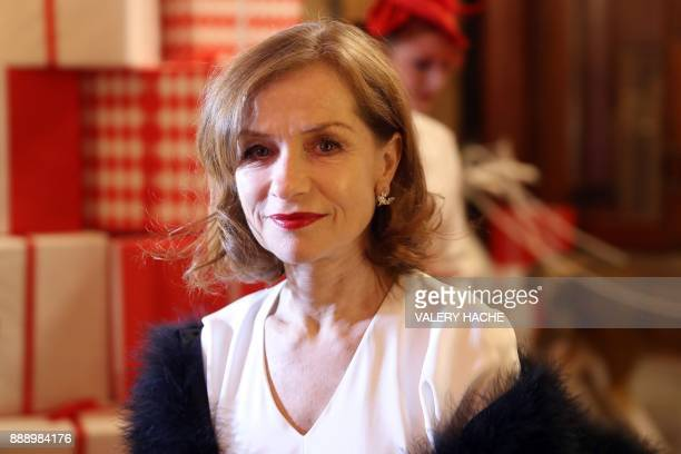 French actress Isabelle Huppert arrives for a Surrealist Dinner Party at the Monte Carlo Casino in Monaco on December 9 2017 / AFP PHOTO / VALERY...