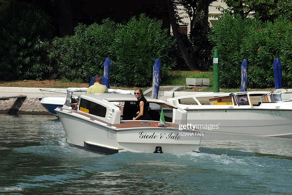 French actress Isabelle Huppert boards a boat at Venice Lido during the 69th Venice Film Festival on September 7, 2012.