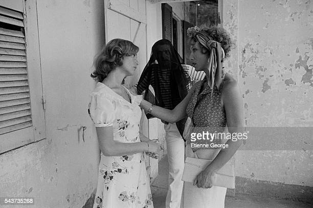 French actress Isabelle Huppert Eddy Mitchell and Stephane Audran on the set of Coup de Torchon written and directed by Bertrand Tavernier | Location...