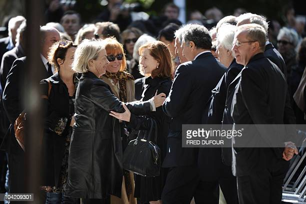 French actress Isabelle Huppert greets French filmmaker Claude Chabrol's widow Aurore Pajot and Chabrol's second wife Stephane Audran on September 17...