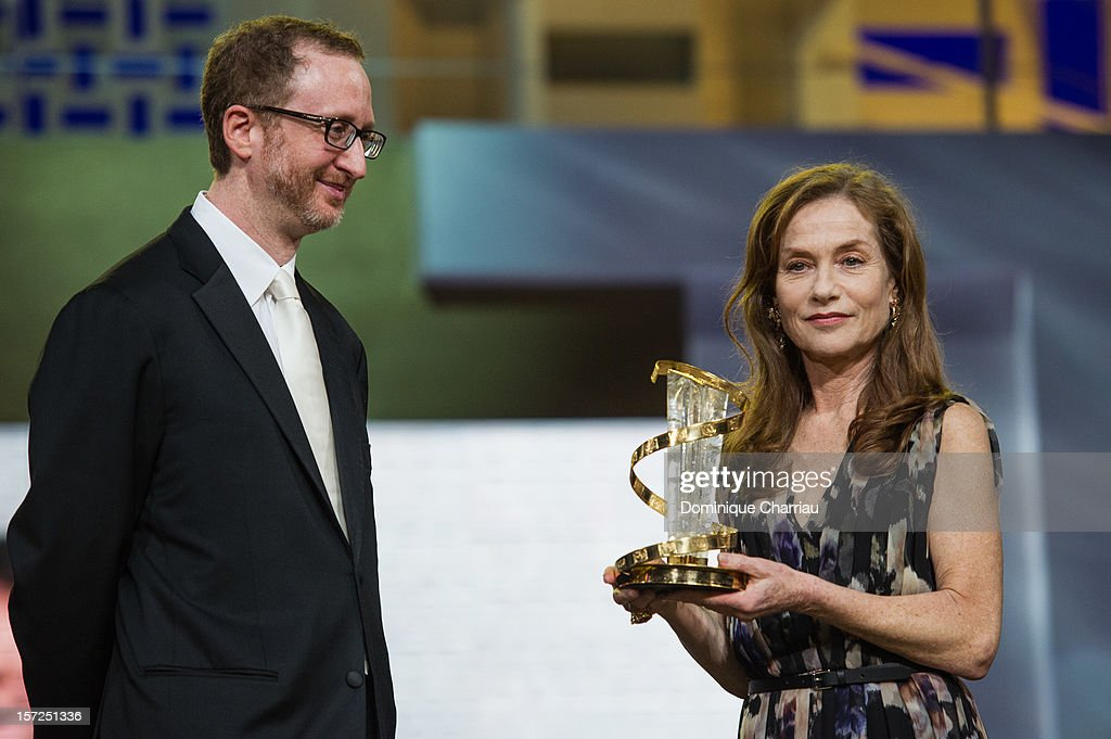 French Actress Isabelle Huppert is awarded by James Gray during her tribute at the opening ceremony of the 12th Marrakech International Film Festival on November 30, 2012 in Marrakech, Morocco.