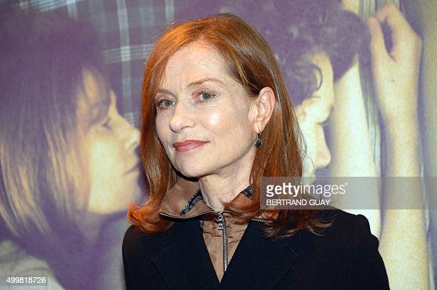 "French actress Isabelle Huppert poses before the screening of the film ""Back Home"" on December 3, 2015 at the UGC cinema in Paris. / AFP / BERTRAND..."