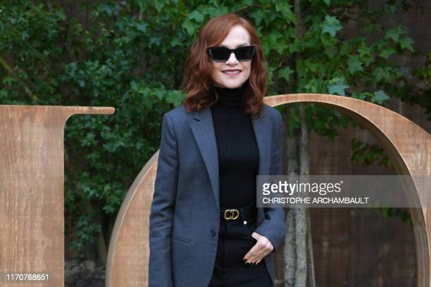 TOPSHOT French actress Isabelle Huppert poses during a photo call prior to the Maison Dior fashion show during the Women's SpringSummer 2020...