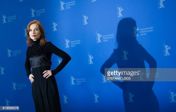TOPSHOT French actress Isabelle Huppert poses during a photocall for the film 'Eva' presented in competition during the 68th Berlinale film festival...