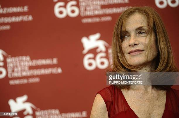 """French actress Isabelle Huppert poses during the photocall of """"White Material"""" at the Venice film festival on September 6, 2009. """"White Material"""" is..."""