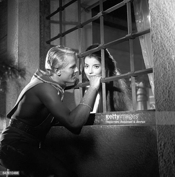 French actress Jacqueline Sassard talking to Italian actor Giuliano Gemma through a grill in My Son the Hero 1961