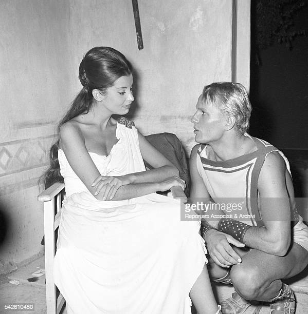 French actress Jacqueline Sassard talking to Italian actor Giuliano Gemma during a break on the set of My Son the Hero 1961