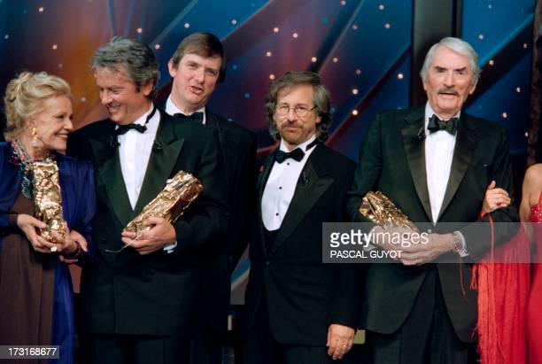 French actress Jeanne Moreau actor Alain Delon British film director Mike Newell US film director Steven Spielberg and US actor Gregory Peck pose...