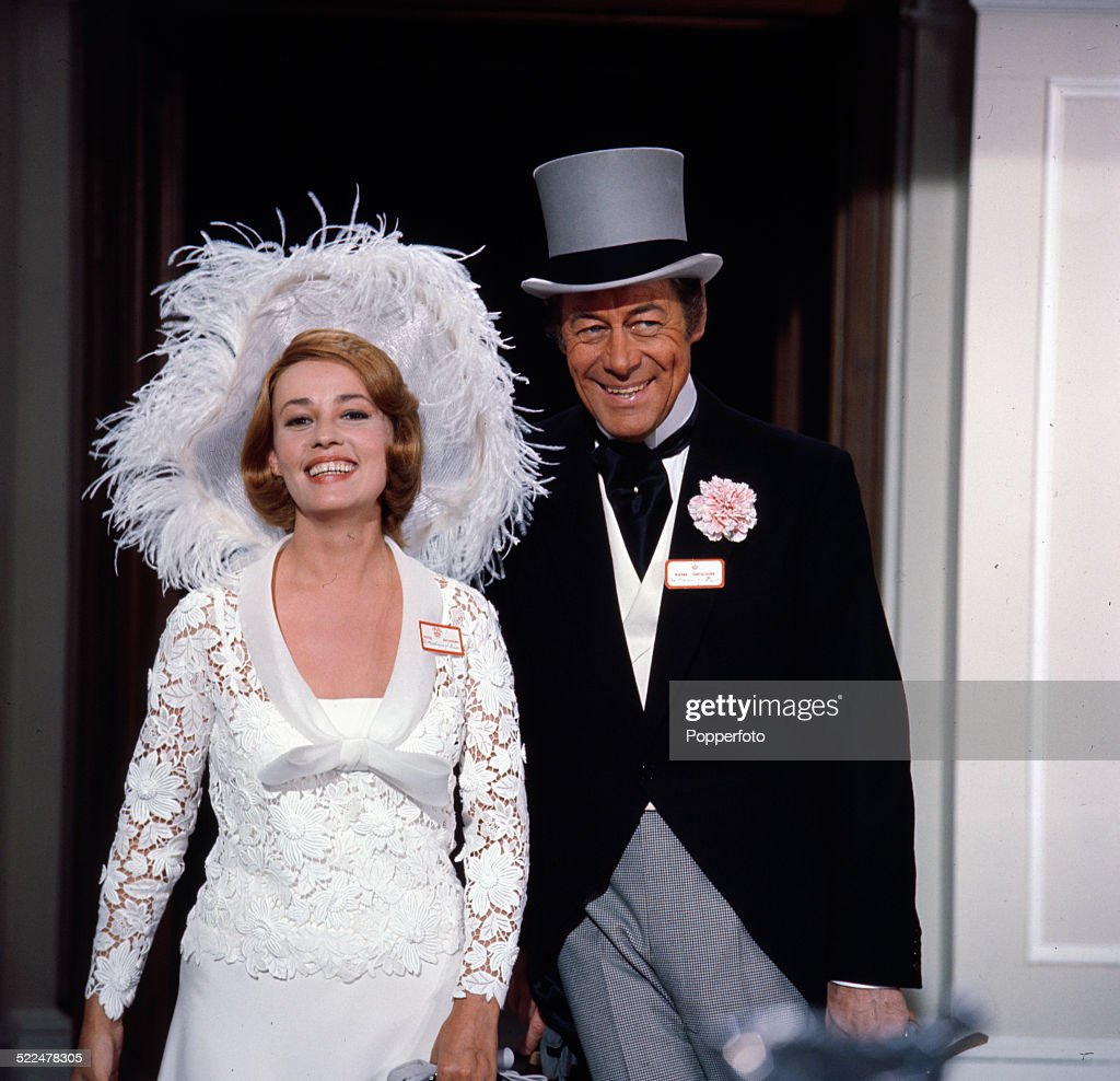 French actress Jeanne Moreau and English actor Rex Harrison (1908-1990) pictured together in character as Lady Eloise Frinton and Lord Charles Frinton in a wedding scene from the film 'The Yellow Rolls-Royce' in 1964.