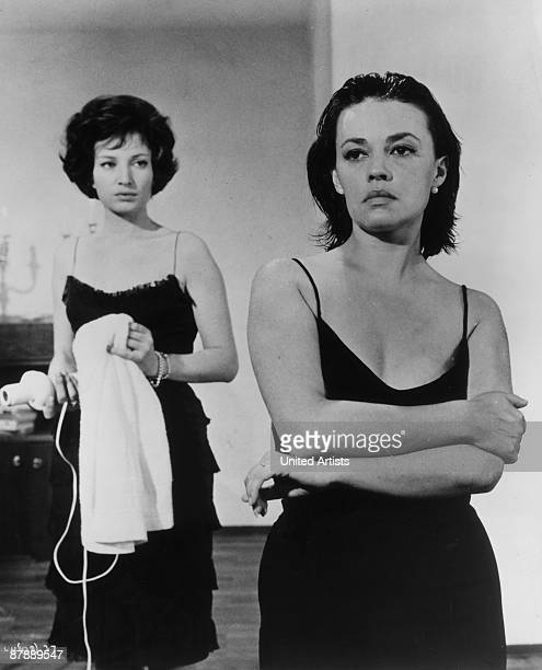 French actress Jeanne Moreau and Italian actress Monica Vitti in a still from director Michelangelo Antonioni's film 'La Notte', 1960.
