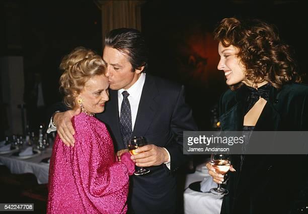 French actress Jeanne Moreau is congratulated by Alain Delon and Valerie Kaprisky after the premiere of the play 'Le Recit de la Servante Zerline'