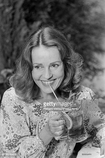 French Actress Jeanne Moreau Sipping a Beverage