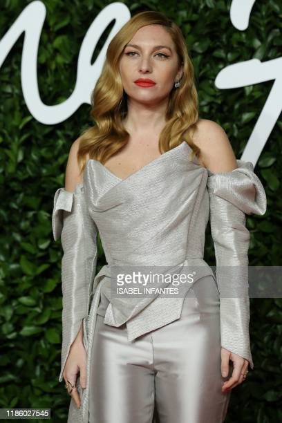 French actress Josephine De La Baume poses on the red carpet upon arrival at The Fashion Awards 2019 in London on December 2 2019 The Fashion Awards...