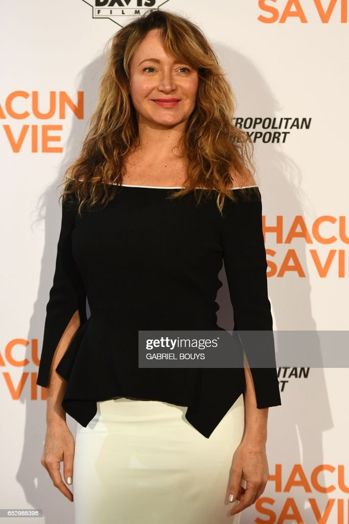 French actress Julie Ferrier poses during the photocall for the premiere of the film 'Chacun Sa Vie' in Paris on March 13, 2017. The film is directed by French director Claude Lelouch. /