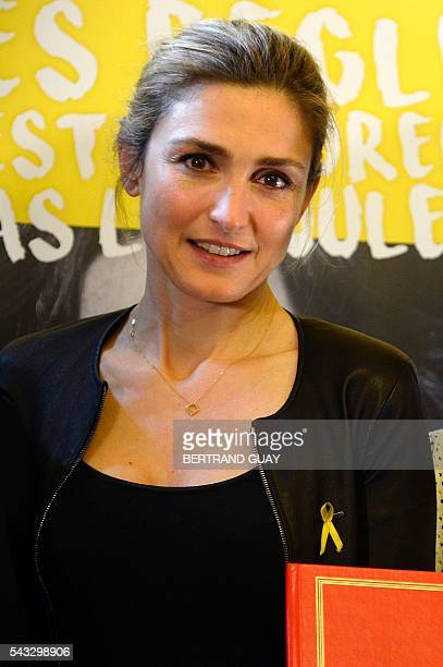 French actress Julie Gayet poses after the signature of the first partnership convention between the Ministry of National Education Higher Education...