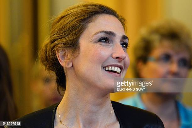 French actress Julie Gayet reacts after the signature of the first partnership convention between the Ministry of National Education Higher Education...