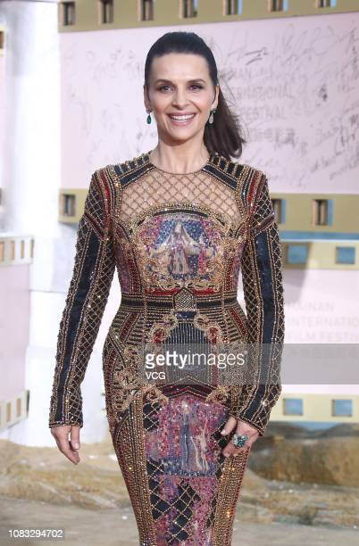 French actress Juliette Binoche arrives at the red carpet during the closing ceremony of 1st Hainan International Film Festival on December 16 2018...