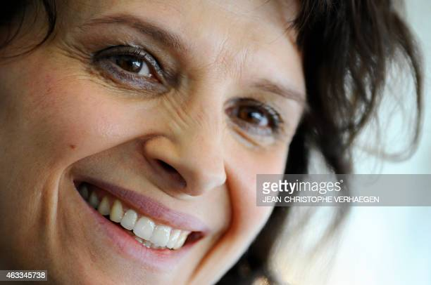 French actress Juliette Binoche gives an interview after a press conference to present Antigone by Sophocles at the Grand Theatre in Luxembourg on...