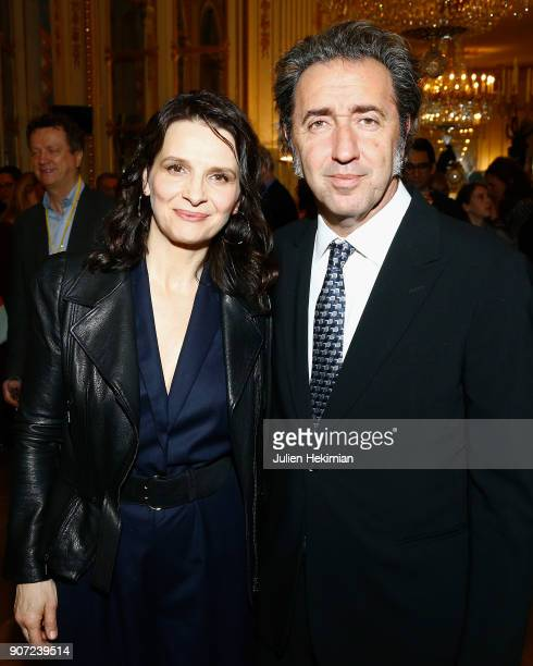 French actress Juliette Binoche is pictured with Italian director Paolo Sorrentino after being awarded with a French Cinema Award by Isabelle...