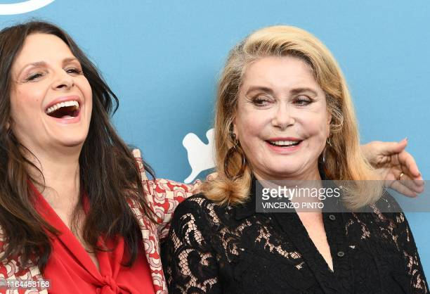 French actress Juliette Binoche laughs as she attends together with French actress Catherine Deneuve a photocall for the film The Truth presented in...