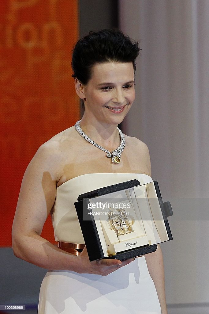 French actress Juliette Binoche poses after winning the Best Actress award for her role 'Copie Conforme' (Certified Copy) during the closing ceremony at the 63rd Cannes Film Festival on May 23, 2010 in Cannes.