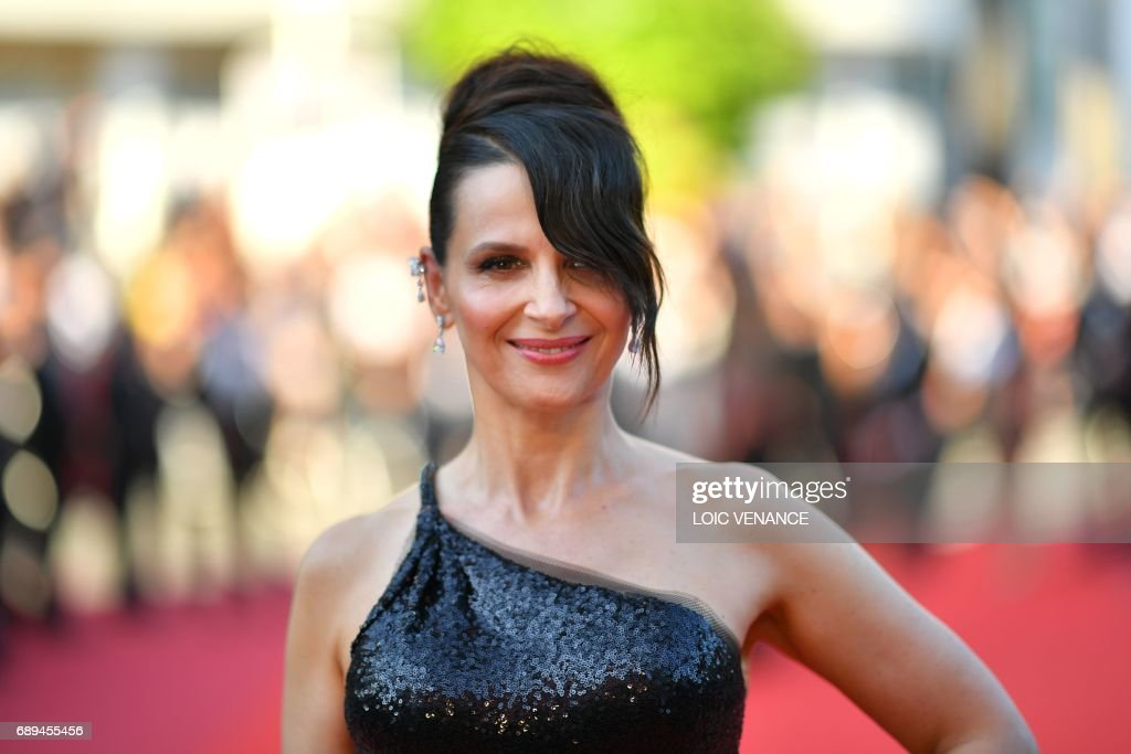 French actress Juliette Binoche poses as she arrives on May 28, 2017 for the closing ceremony of the 70th edition of the Cannes Film Festival in Cannes, southern France. /