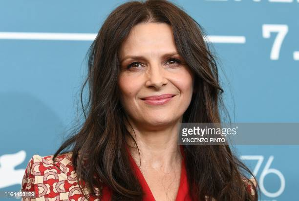 TOPSHOT French actress Juliette Binoche poses during a photocall for the film The Truth presented in competition on August 28 2019 during the 76th...
