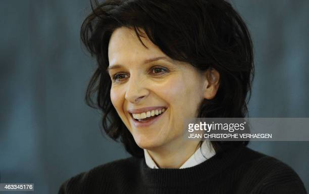 French actress Juliette Binoche smiles during a press conference to present Antigone by Sophocles at the Grand Theatre in Luxembourg on February 13...