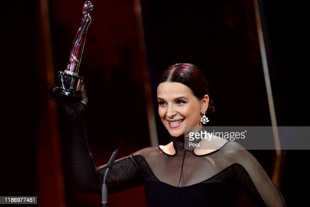 French actress Juliette Binoche speaks after being awarded the European Achievement in World Cinema award onstage during the 32nd European Film...