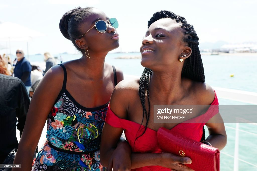 French actress Karidja Toure (L) and French actress Assa Sylla, members of a group of 16 black women who fight for equality and inclusion of black women in the French film industry, pose on May 17, 2018 during a photocall for the book 'My Profession is Not Back' on the sidelines of the 71st edition of the Cannes Film Festival in Cannes, southern France.
