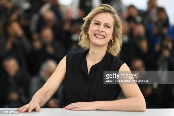 """French actress Karin Viard poses on May 14, 2018 during a photocall for the film """"Little Tickles """" at the 71st edition of the Cannes Film Festival in..."""