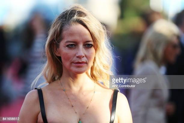 French actress Laure Marsac poses on the red carpet before the opening ceremony of the 43rd Deauville US Film Festival on September 1 in the French...