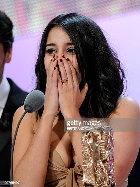 French actress Leila Bekhti reacts after winning the Best Newcomer award for French directors Herve Mimran and Geraldine Nakache's film Tout ce qui...