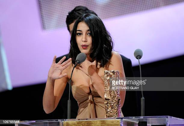 French actress Leila Bekhti talks after winning the Best Newcomer award for French directors Herve Mimran and Geraldine Nakache's film Tout ce qui...