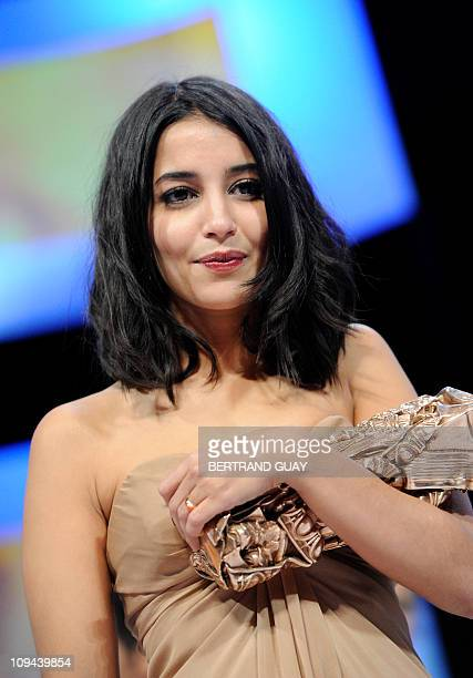 French actress Leila Bekti holds her trophy after winning the Best Newcomer award for French directors Herve Mimran and Geraldine Nakache's film Tout...