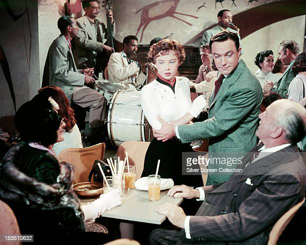 French actress Leslie Caron as Lise Bouvier, and American actor and dancer Gene Kelly as Jerry Mulligan, in 'An American in Paris', directed by...
