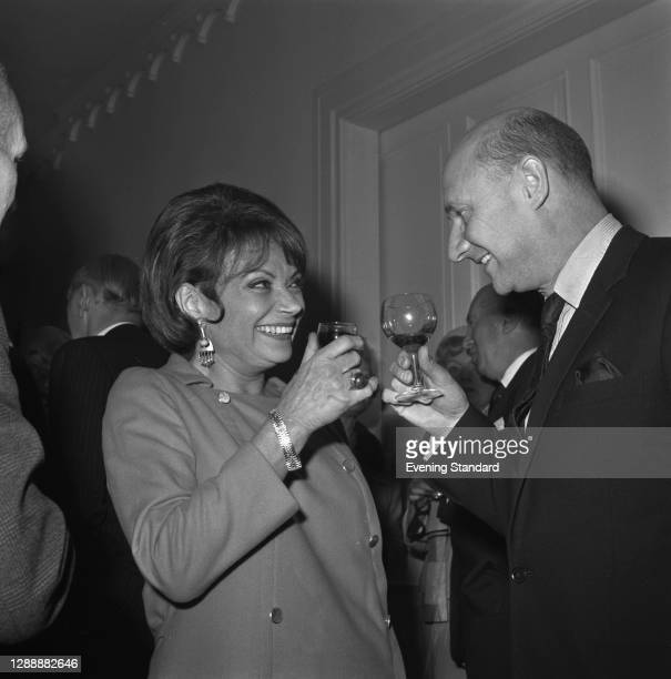 French actress Lila Kedrova chats with English actor Donald Pleasence at the Evening Standard Theatre Awards for 1967, London, UK, 16th January 1968....