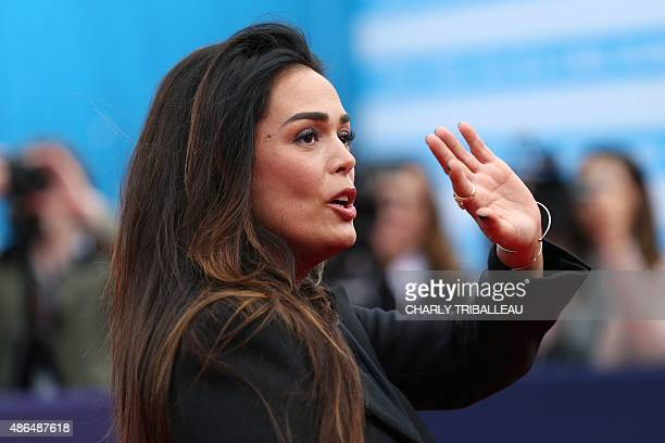 French actress Lola Dewaere gestures as she poses on the red carpet before the screening of the movie Everest on September 4 2015 during the 41th...