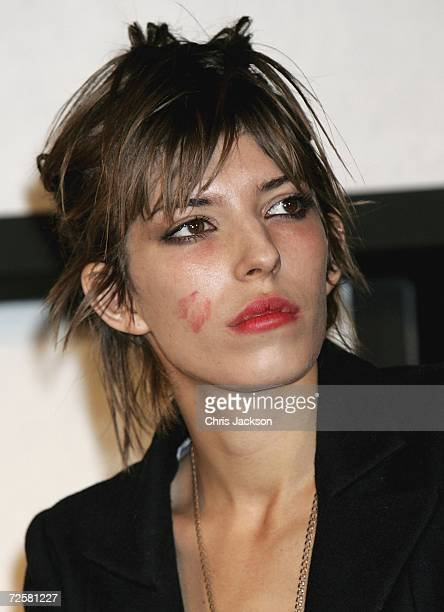 French actress Lou Doillon on stage with makeup on her face after being kissed by Sopia Loren as she takes part in a press conference at the launch...