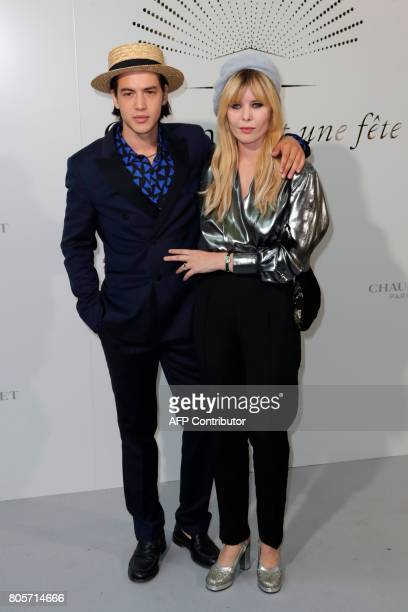 French actress Lou Lesage and French actor Arthur Jacquin pose during a photocall as part of an event organised by French jeweller Chaumet on July 2...